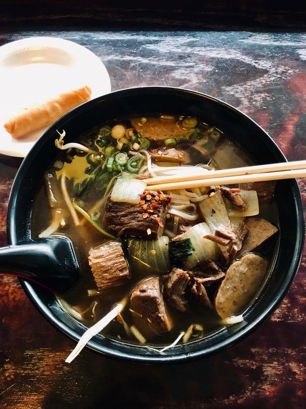bowl of pho with chopsticks