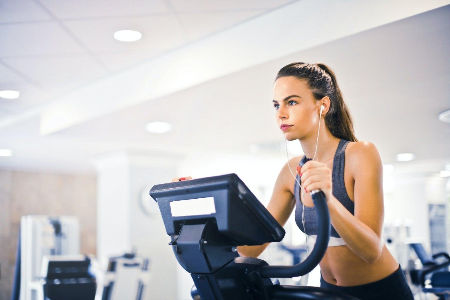 woman on workout machine