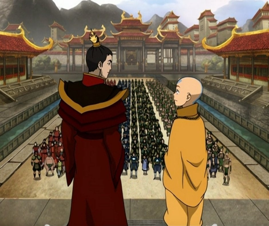 Zuko and Aang looking at each other while standing in front of crowd