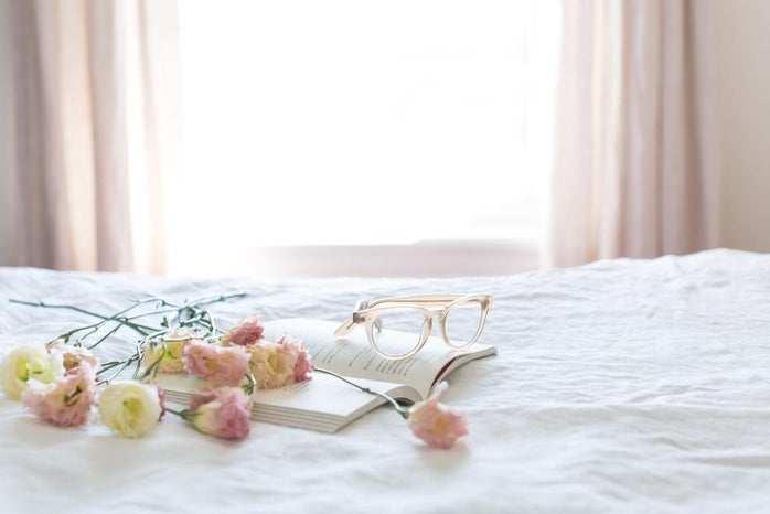 Flowers on book, along with glasses
