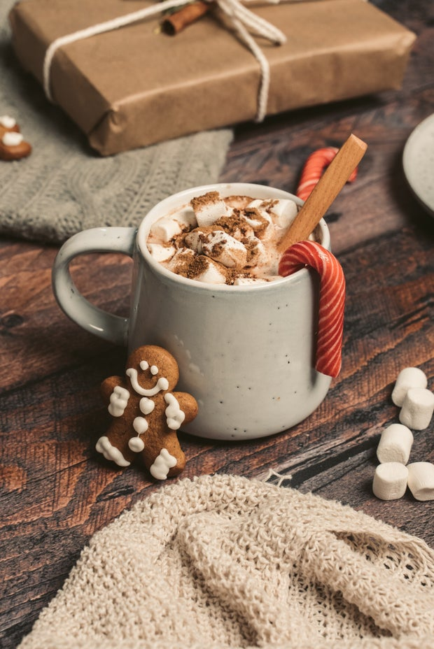 White Ceramic Mug With Brown Wooden Spoon