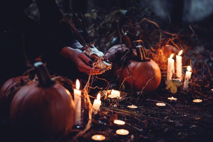 pumpkins, candles, and skull