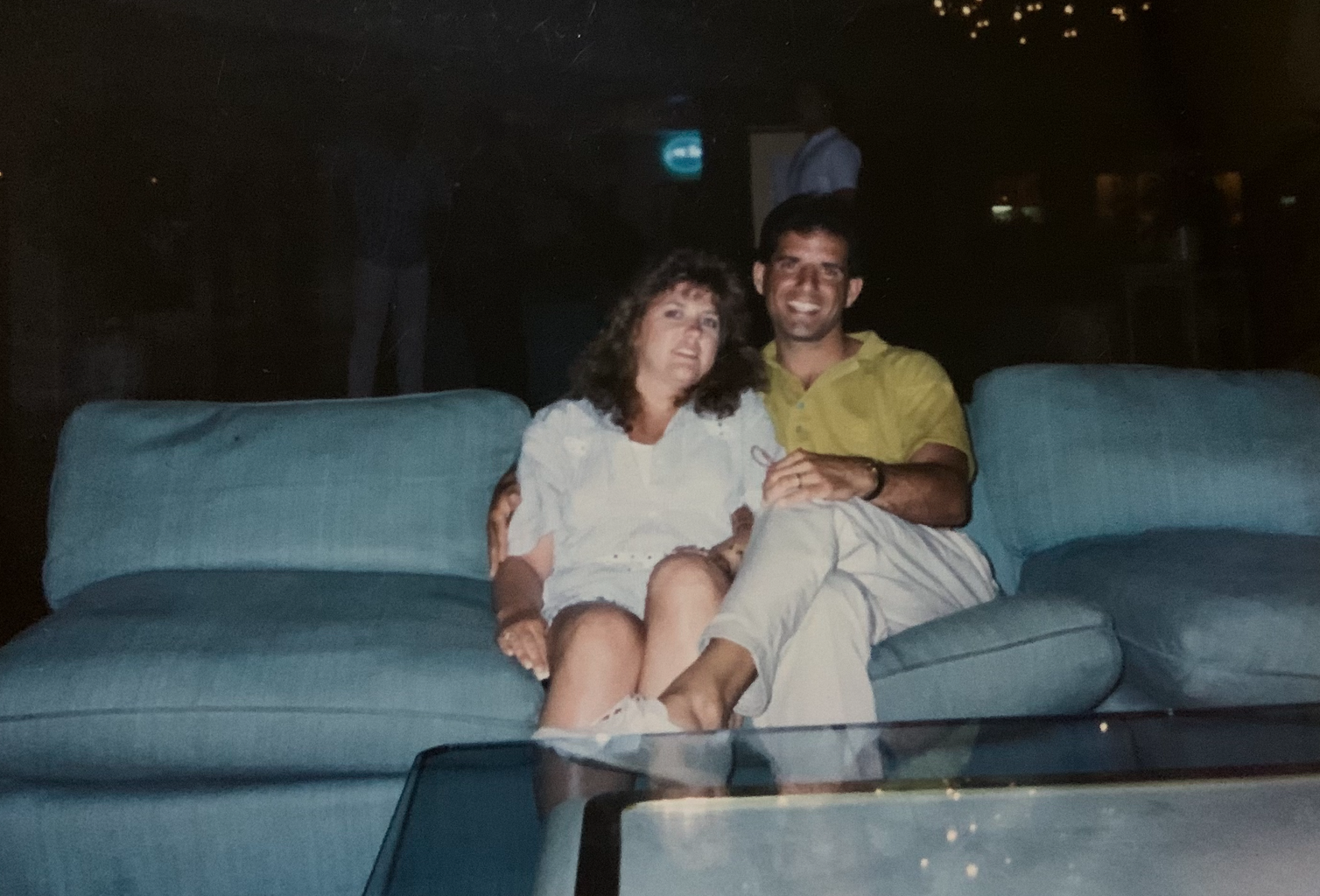 Photo of a couple posing together on a couch