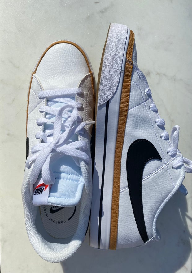 White sneakers with nike check mark