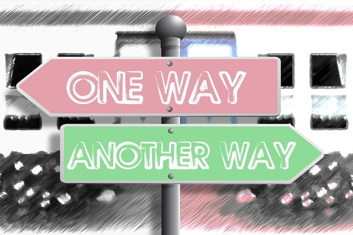 Signs pointing opposite directions
