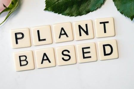 """Plant Based"" written on tiles on countertop"