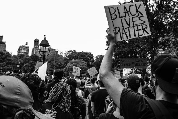 greyscale photo of a Black Lives Matter protest