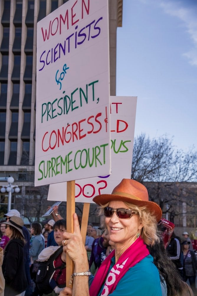 Sign calling for more women in public office