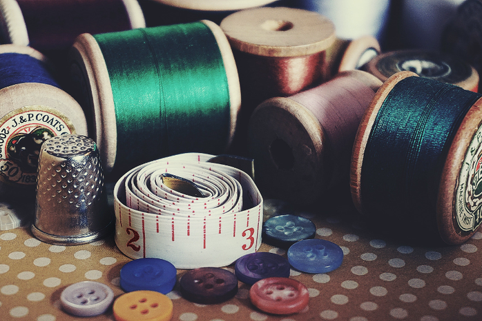 thread, tape measure, and buttons for sewing