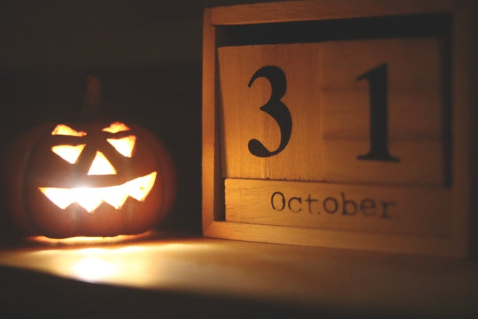 Jack o lantern and date on table