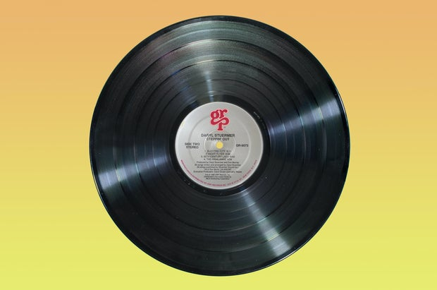 vinyl record on yellow background