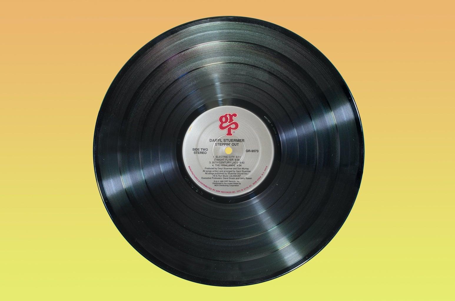 vinyl record on yellow background