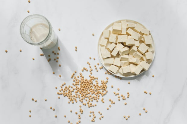 Tofu, chickpeas, and soy milk on a table