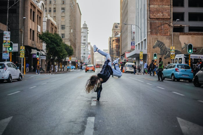 woman dancing in the middle of the street