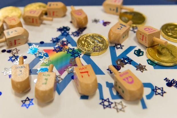 dreidel, gelt, and jewish stars for hanukkah celebrations