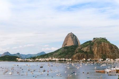 Pão de Açucar hill in Rio de Janeiro and body of water.