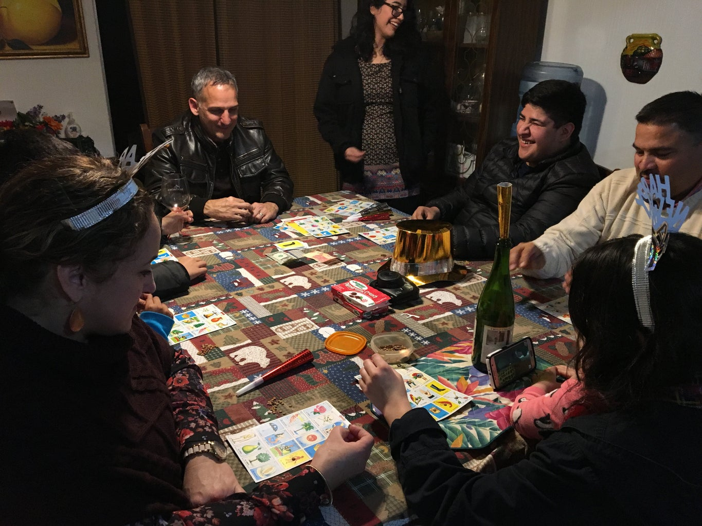 family playing loteria, a Mexican bingo game