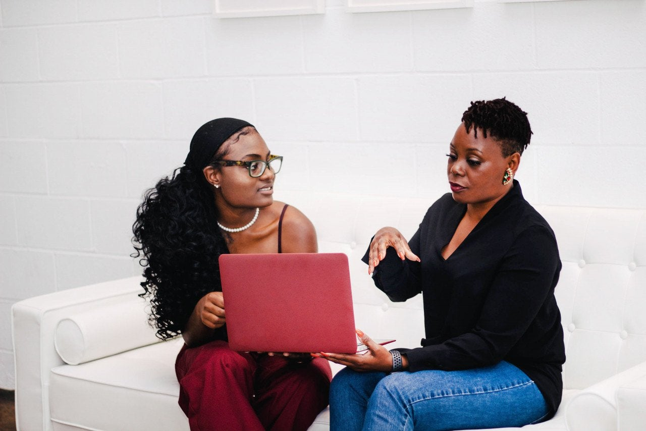 Two women with a laptop