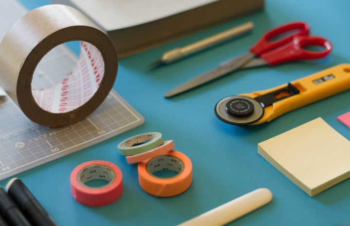 craft supplies on blue table
