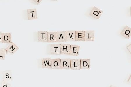 "Scrabble letters spelling ""Travel the world"""