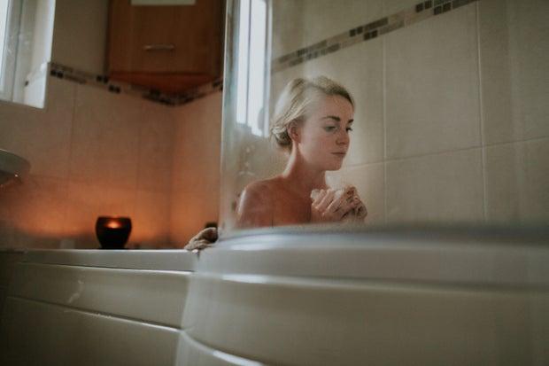 woman sitting inside bathtub
