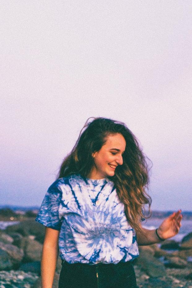 Woman in tie dye shirt