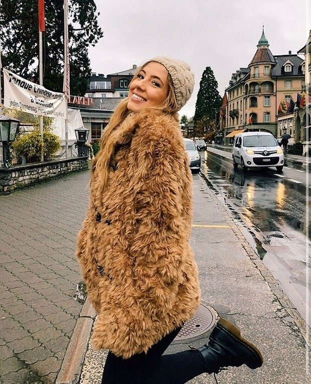 young woman with tan furry jacket