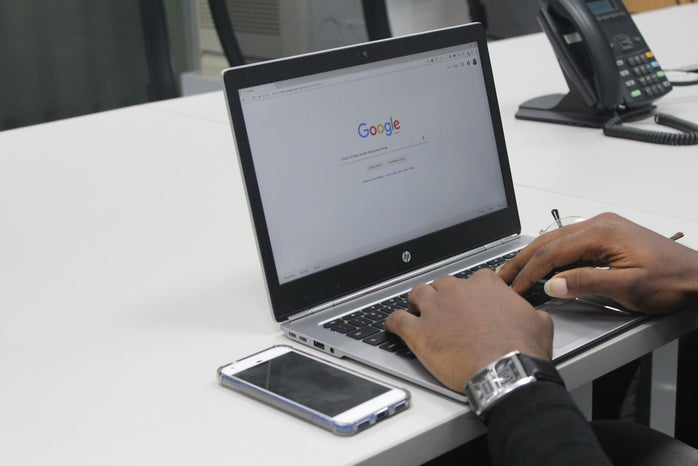 laptop open to Google search bar