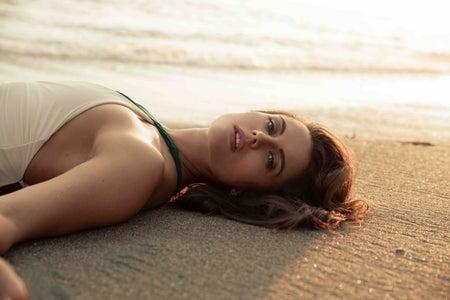 Gedina laying down on beach