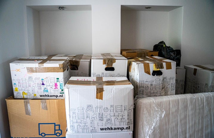 cluster of cardboard moving boxes