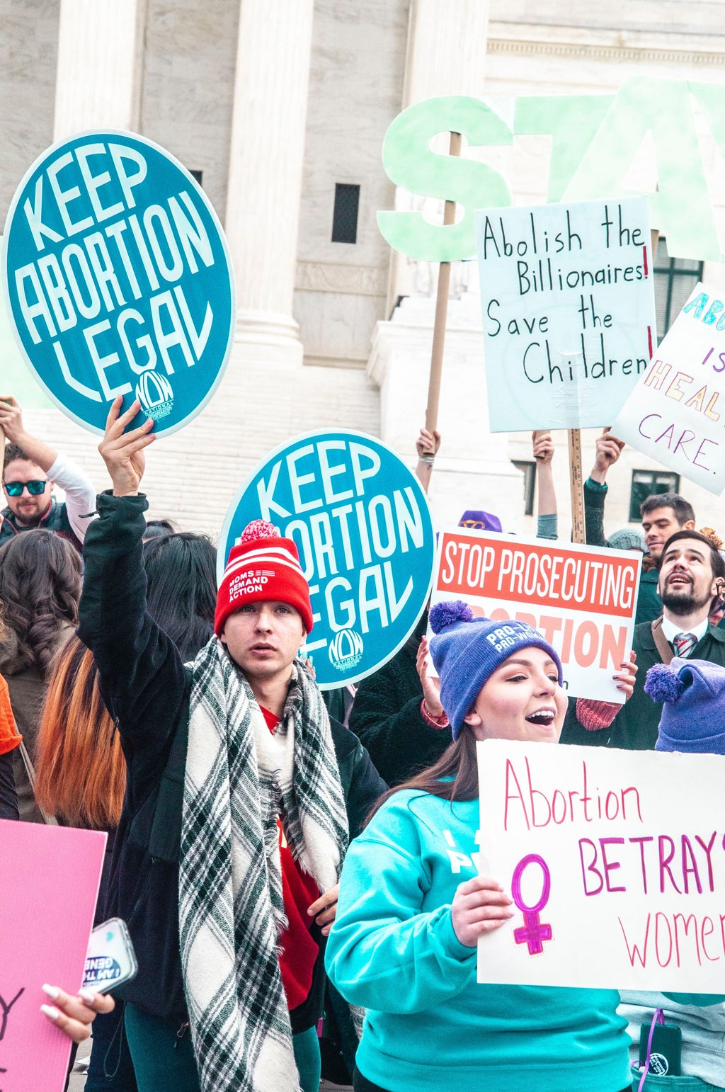 People holding signs at a pro-choice rally in Washington D.C