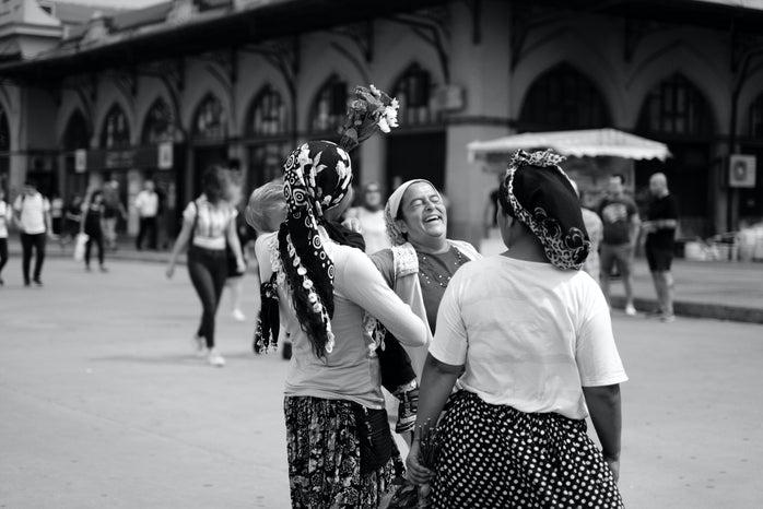 Romani women laughing