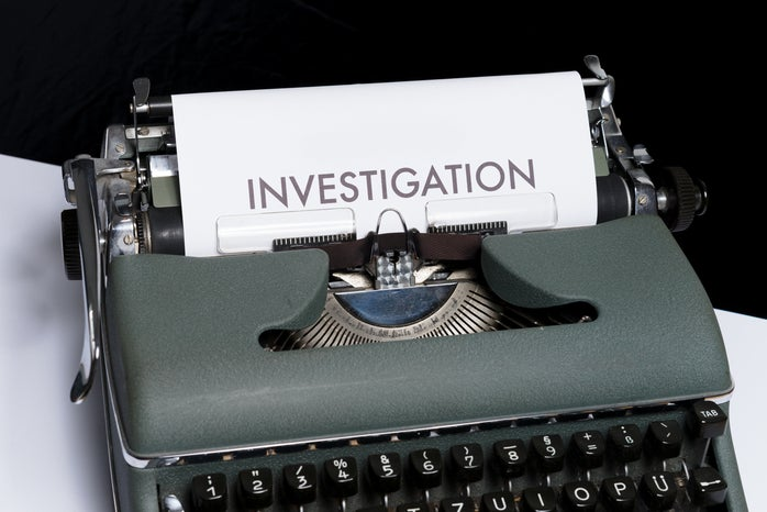 Investigation typed on paper