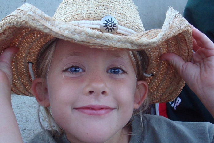 Childhood photo with a cowboy hat