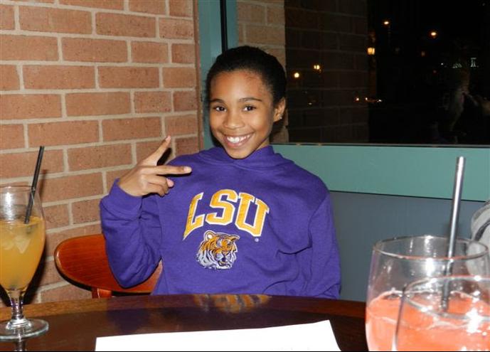 little girl in college sweatshirt