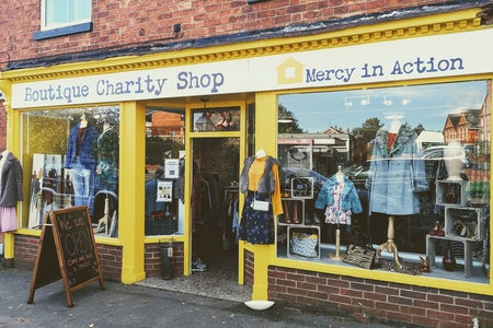 Front of a charity shop- Mercy in Action boutique
