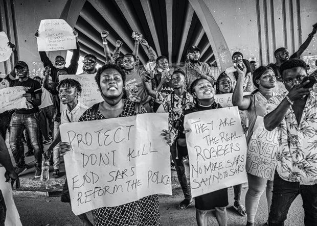 Nigerian men and women protesting SARS