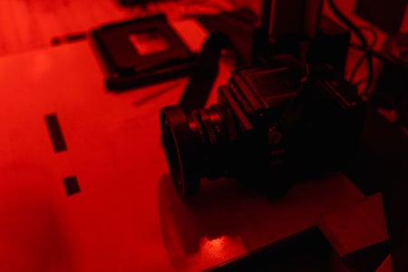 black camera on a table in red lighting