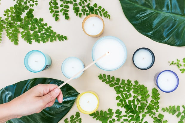 multiple candles surrounded by greenery