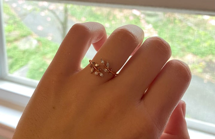Hand with dainty leaf ring