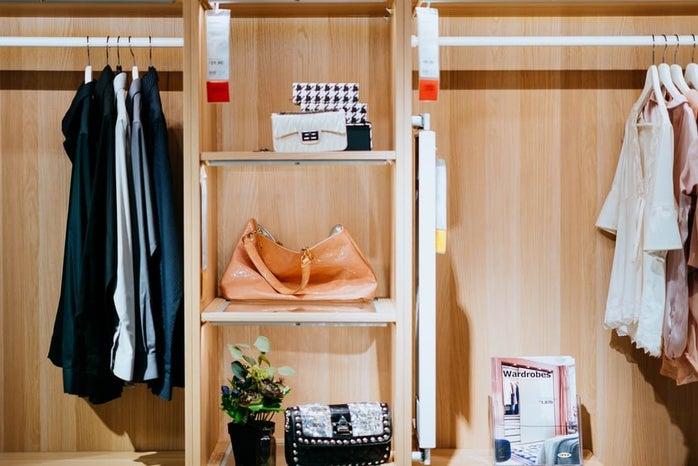 organized closet with shelves and decor