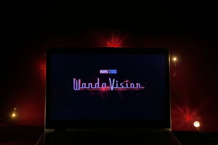 WandaVision show on laptop with twinkling lights