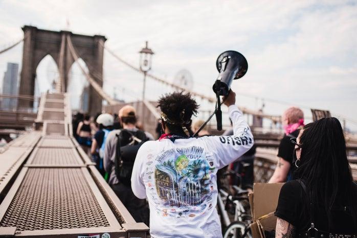 people protesting on a bridge