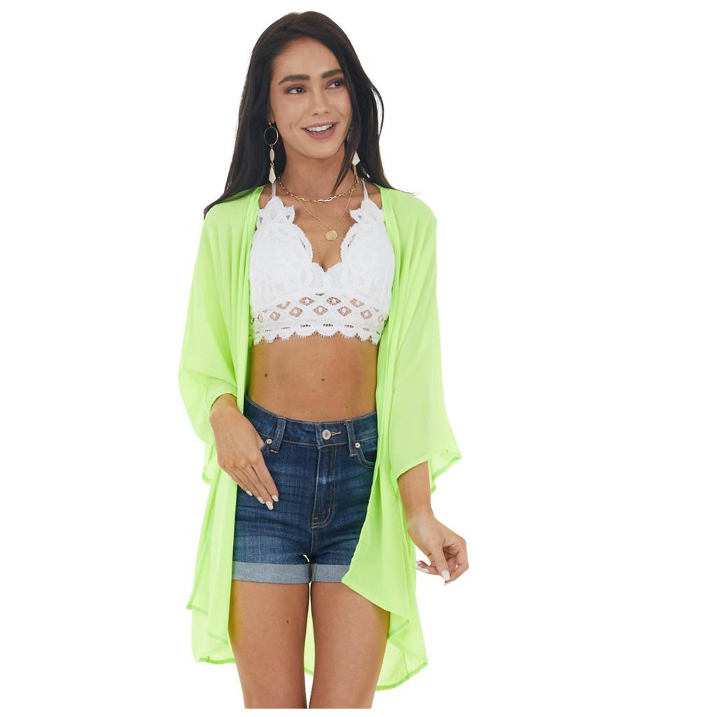 woman wearing a neon cardigan