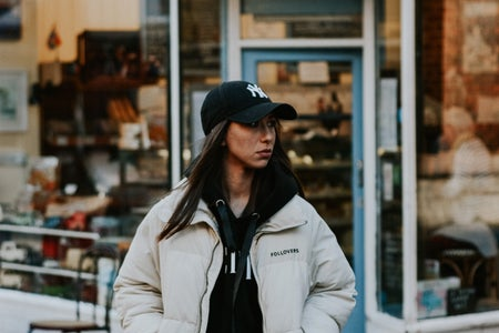 woman wearing puffer jacket and hat fashion in Bristol