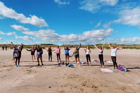 Women at a beach workout