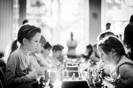 Girls playing Chess