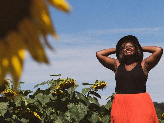 Woman smiling in sunflower field