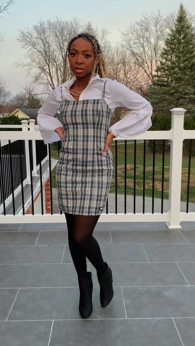 young woman wearing plaid dress