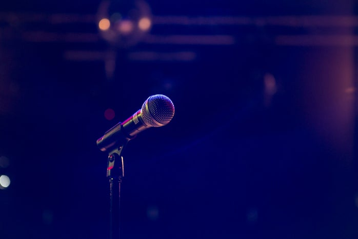 microphone with dark blue lighting in background